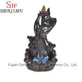 Hornilla de incienso de cerámica del humo de Ganesh que se sienta en la etapa del loto