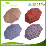 열려있는 설명서와 가까운 3개의 겹 우산을 인쇄하는 가장 싼 디지털