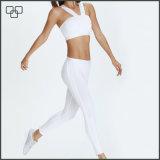 Alti pantaloni elastici rapidamente asciutti di yoga