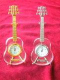 Reloj de la guitarra de cristal