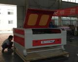 木製のアクリルの革布自動レーザーの切断の彫版機械