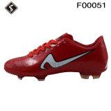 Zapatos al aire libre del fútbol de los hombres y de los cabritos