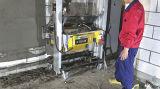 Pared del material de construcción que enyesa la máquina