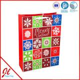 Le cadeau de papier élégant de estampage d'un rouge ardent met en sac les sacs à provisions de papier pour Noël 2016