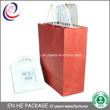 Saco de papel luxuoso feito sob encomenda do presente da compra com a venda por atacado da cópia do logotipo