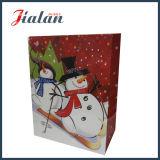 A promoção por atacado 4c imprimiu o saco do presente do papel do Natal do projeto do boneco de neve