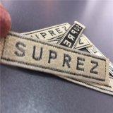 Material personalizado de oro brillante brillante Etiquetas ropa etiquetas Nombre de marca Etiquetas Etiquetas tejidas Etiquetas de prendas de vestir