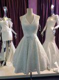 上の販売のホールターの不足分の弓が付いているアイボリーのレースのウェディングドレス