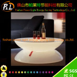 Les meubles d'éclairage d'humeur de DEL s'allument autour de la table lumineuse