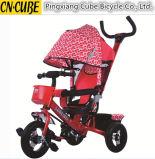 1台の子供の三輪車、ベビーカーに付き子供のおもちゃ4台