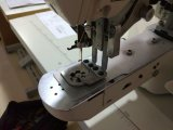 Bouton fixant la machine pour les boutons spéciaux
