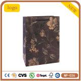 Fleurs bleues noires et profondes vêtant le sac de papier d'emballage de cadeau d'achats