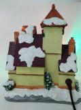 El LED pintado a mano al por mayor enciende la casa de la Navidad de los edificios de la resina