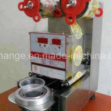 máquina plástica manual del lacre de la taza con una o varias molde
