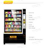 軽食のためのエレベーターの自動販売機か飲み物または野菜またはサラダ