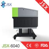 切り分けるJsx-6040印二酸化炭素レーザーの彫版機械を広告する