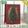 Saco de papel do presente da árvore de Natal do verde do papel revestido