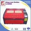 木製のアクリルのペーパーのためのLiaocheng Julong 900*600mmレーザーの彫版機械価格