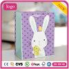 Bolsas de papel revestidas del regalo del arte púrpura del conejito de Pascua