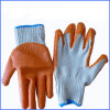 Guanti di gomma arancioni del cotone della famiglia
