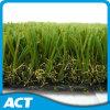 Verde più scuro che modific il terrenoare erba artificiale per la superficie dell'ammortizzatore del giardino