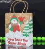Saco bonito da embalagem do presente do Natal com punho e fita