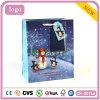 Bolsa de papel azul del muñeco de nieve del pingüino de la Navidad