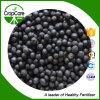 Estado granular de adubos compostos 35% de NPK 25-5-5 na cor preta
