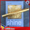 Rueda del oro del brillo 24k sobre papel en el papel del cáñamo