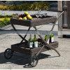 2つの車輪が付いている藤の庭の家具セットそしてテラスの家具の食堂車
