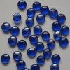 Branelli di vetro blu del ciottolo della roccia