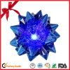 Iridiscente de la estrella del arco para la Navidad o deshierbe