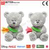 Día suaves de los juguetes de peluche de Aniaml oso de San Valentín que sostiene las flores para la esposa