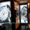 Horloge dat met TextielVertoning voor het Teken van de Muur van de Winkel adverteert