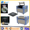 China mejor precio de vidrio acrílico grabado láser Máquina de corte/caucho