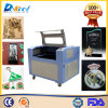 Máquina do gravador do cortador do laser do CO2 do CNC 6090 para o acrílico de madeira