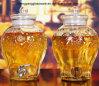 Grande frasco de vidro do armazenamento da bebida com tampa e a torneira de vidro