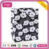 Weiße Blumen-Muster-Schwarz-Bekleidungsgeschäft-Kunst-Geschenk-Papierbeutel