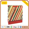 Bolso de compras rojo y amarillo del papel revestido de la raya