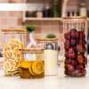Tarro del almacenaje del vidrio de Borosilicate con el anillo de bambú de la tapa y del silicón para la cocina