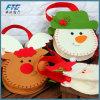 Noël en gros décorant des sacs d'emballage de sucrerie