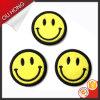 Hierro en divisas amarillas del bordado de la cara de la sonrisa