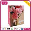 Penoy colorido florece el bolso de compras del papel revestido