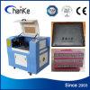 Mini grabado láser de CO2 precio de la maquinaria para vidrio Goma de papel