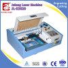 Petite machine de découpage de gravure de laser d'affaires de Mde de pierre à aiguiser