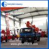 Установленная трактором буровая установка добра воды
