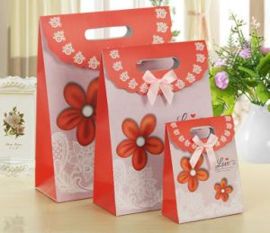 Wholesale and Customize Korean Flip Christmas Gift Bag with Beautiful Bowknot pictures & photos