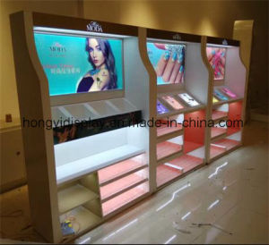 Cosmetic Round Acrylic Display Table with LED Light pictures & photos