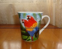 White Porcelain Mug with Parrot Designs pictures & photos
