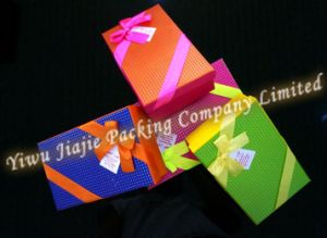 Colorful Gift Box Decorated with Ribbon and Bownot